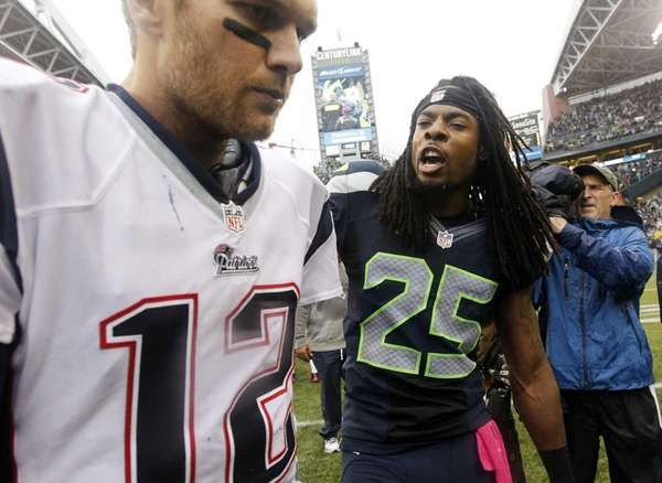 Seattle Seahawks cornerback Richard Sherman talks with New