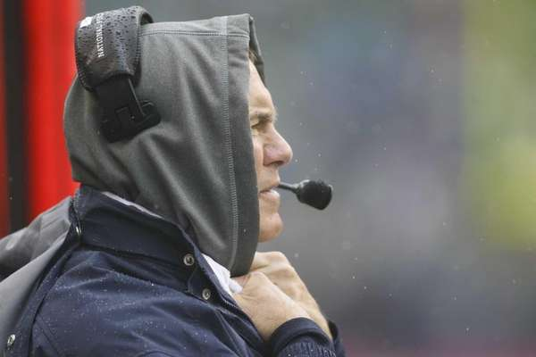 New England Patriots head coach Bill Belichick watches