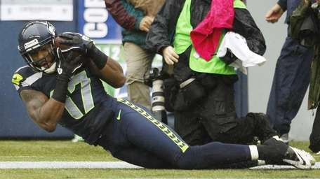 Seattle Seahawks' Braylon Edwards catches the ball for