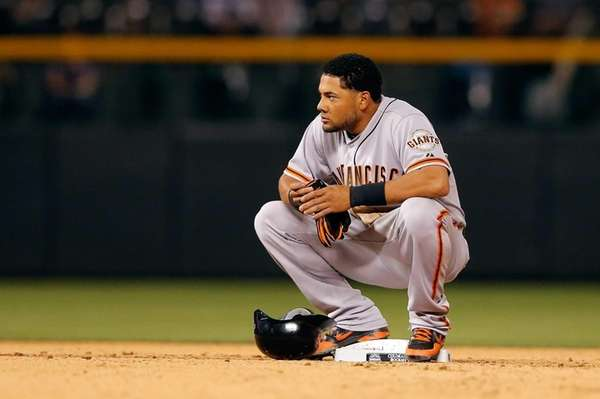 Giants centerfielder Melky Cabrera looks on during a
