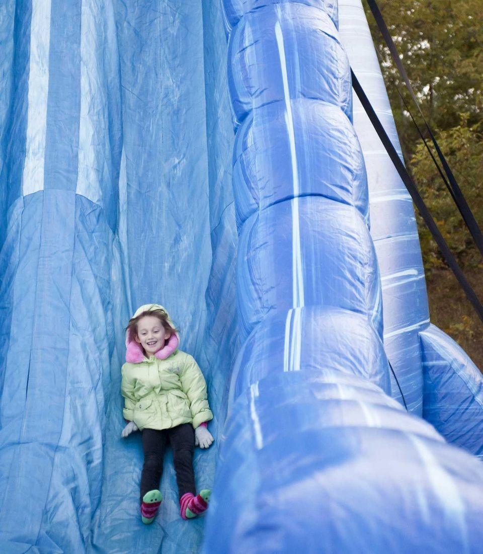 Smithtown's Ashley Fioramonti, 6, comes down a slide