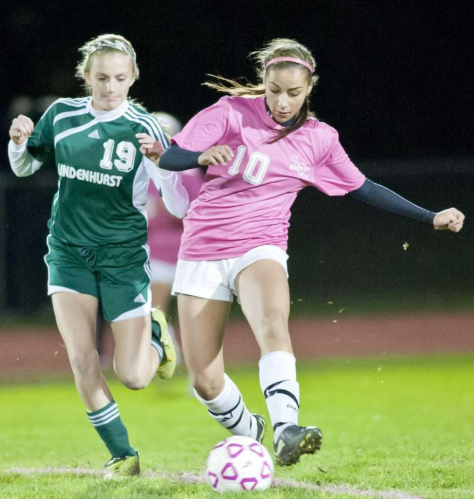 Hauppauge's Juliette Loccisano, right, goes after the ball