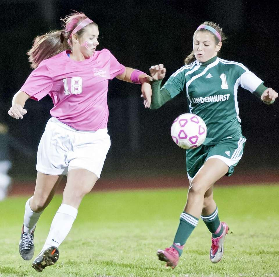 Hauppauge's Darla Poulin, left, goes after the ball