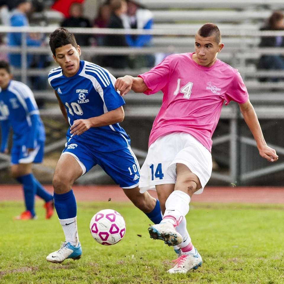 Hauppauge's P.J. Contreras, right, takes a shot against