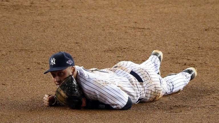 Derek Jeter reacts after he injured his leg