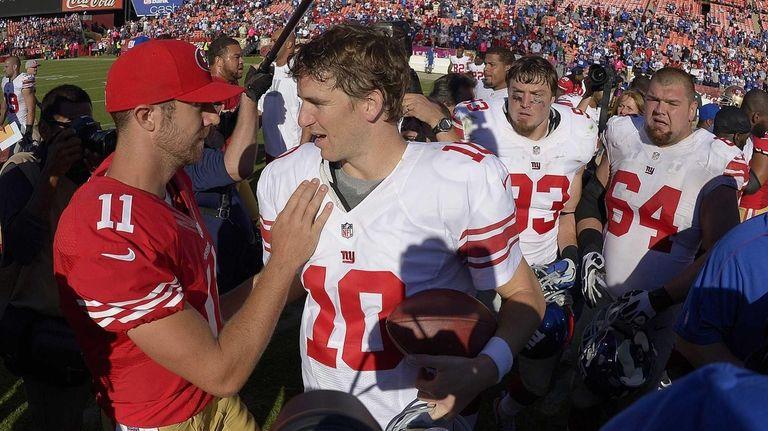 San Francisco 49ers quarterback Alex Smith greets Giants