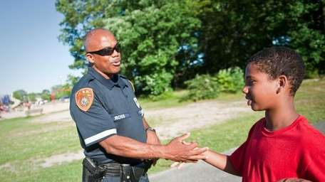 Suffolk County COPE Officer Charles Ross slaps hands