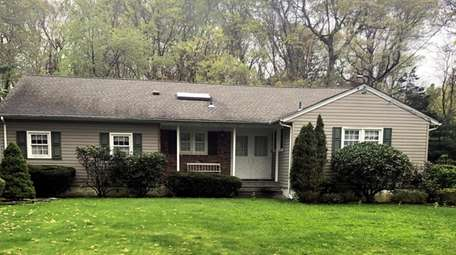 This three-bedroom, two-bathroom ranch on Chestnut Stump Road