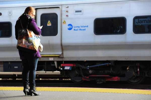 An LIRR commuter waits at the Long Beach