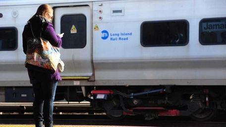 An LIRR commuter waits at the Long Beach