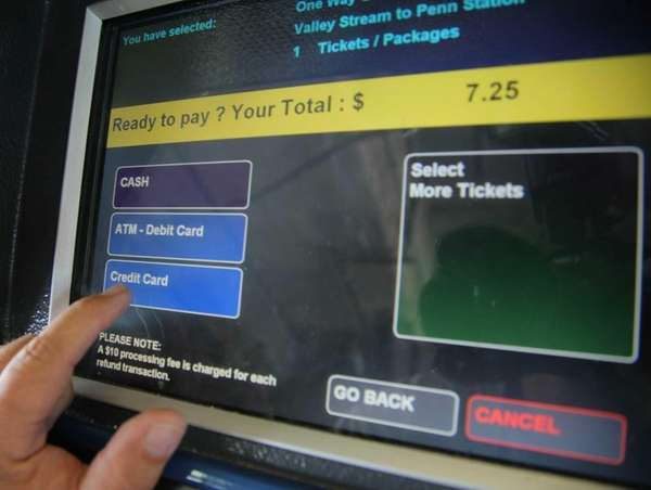 A commuter uses a ticket machine at the