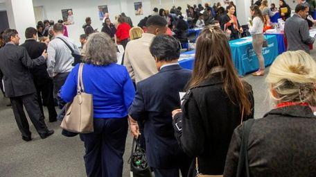 Job applicants wait in line at a job