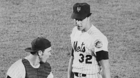 Lefty Jon Matlack, shown in a mound conference
