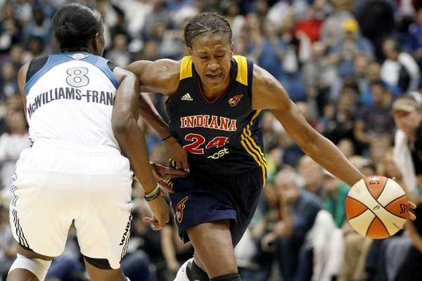 Indiana Fever forward Tamika Catchingsis fouled by Minnesota