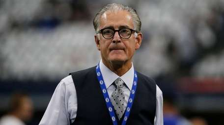 Former NFL official Mike Pereira walks across the