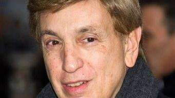 Marv Albert arrives for a taping of the