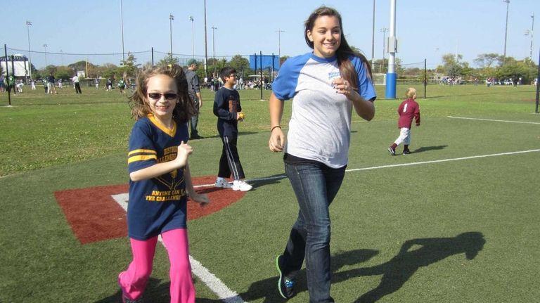 Amanda Dunn, 12, runs with baseball buddy Jessica
