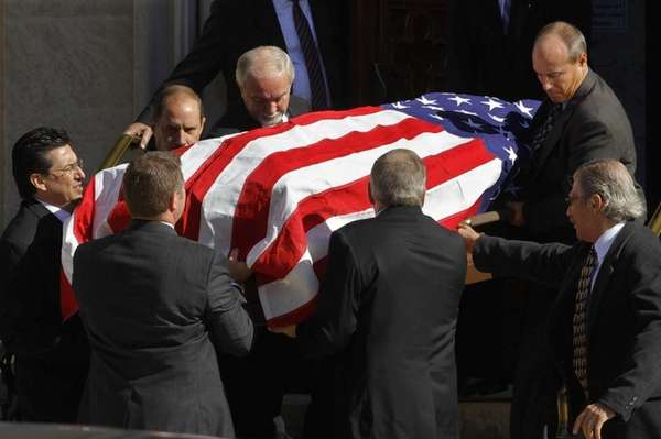 Pallbearers carry the casket of Jerry Girardi, the