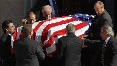 Pallbearers carry the casket of Jerry Girardi, the