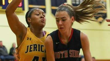 Jericho's Samara Jenkins keeps a tight defense on