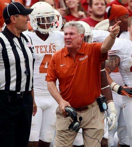 Texas head coach Mack Brown yells at an