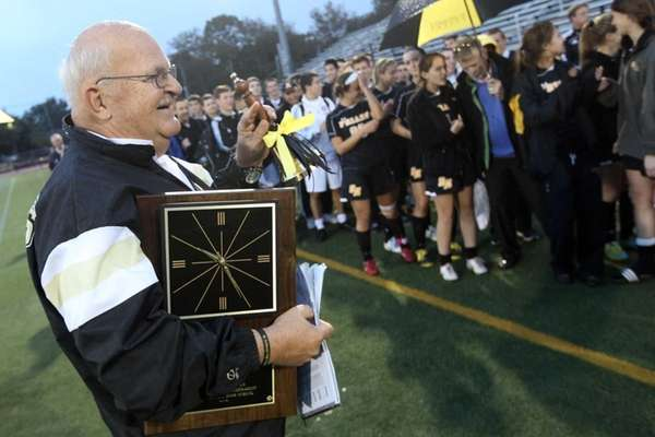 St. Anthony's Head Coach Dave Prutting is applauded
