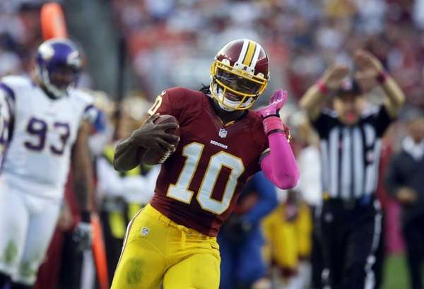 Washington Redskins quarterback Robert Griffin III reacts after