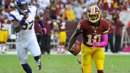 Washington Redskins quarterback Robert Griffin III gets away