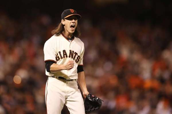 Tim Lincecum celebrates after David Freese hits into