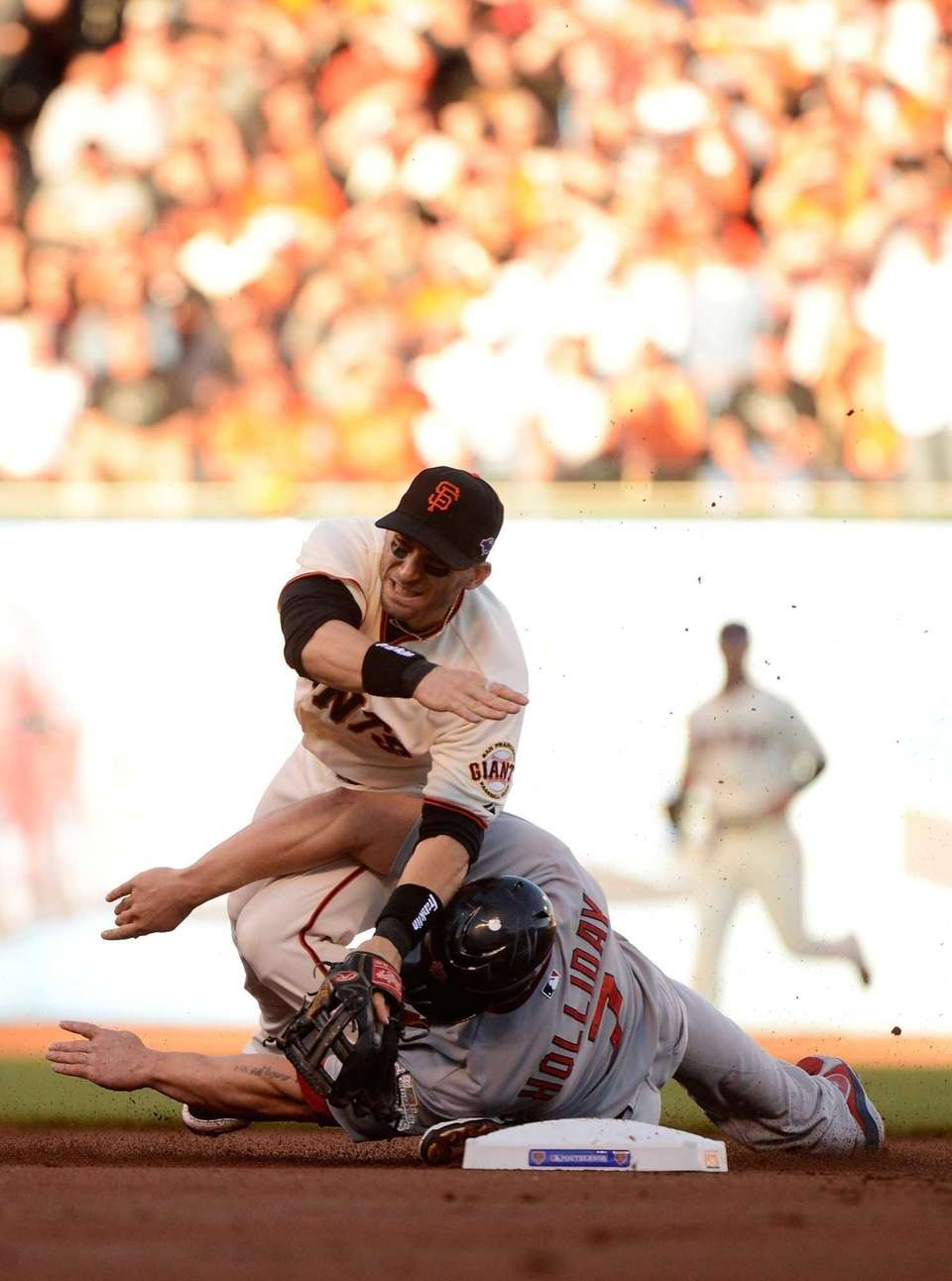 Matt Holliday slides into second knocking over Marco