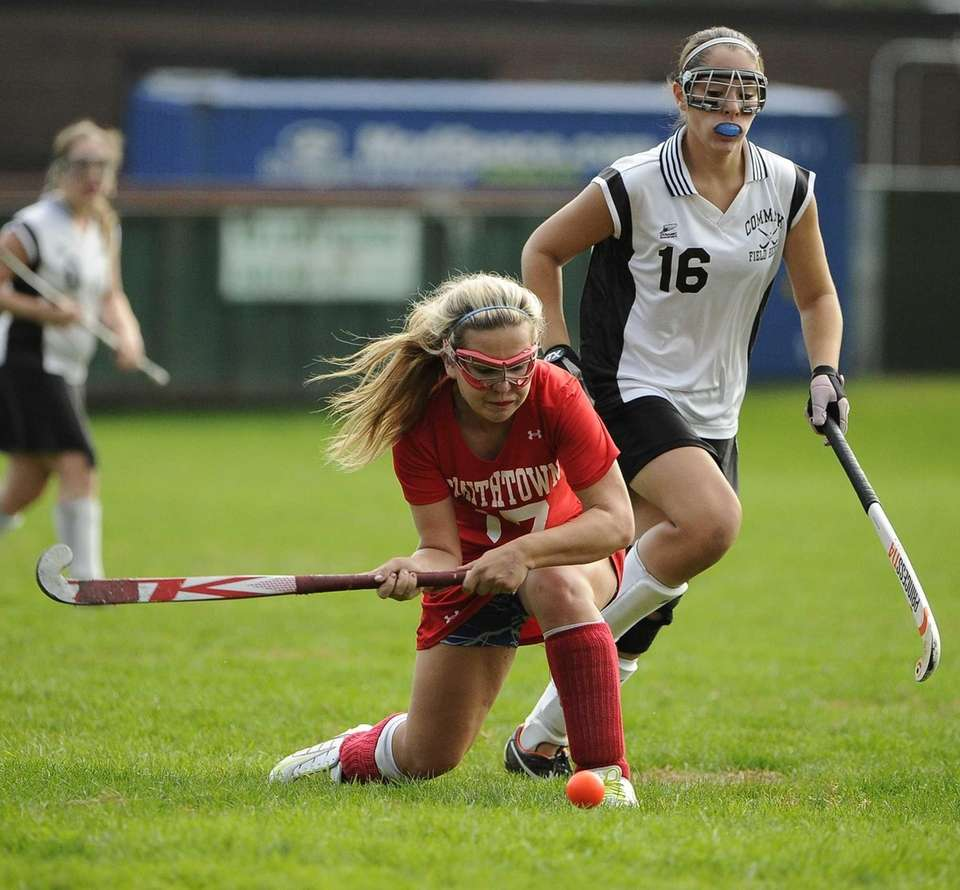 Smithtown East's Lauren DeBetta passes the ball ahead
