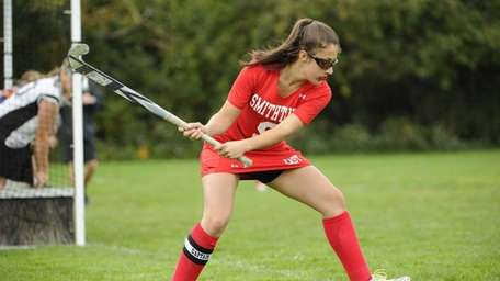 Smithtown East's Madison Annitto sets up to push