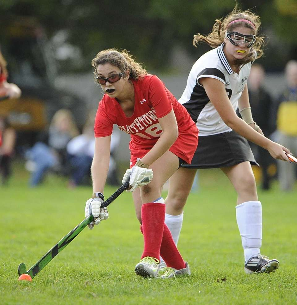 Smithtown East midfielder Emily DeMarinis looks to pass