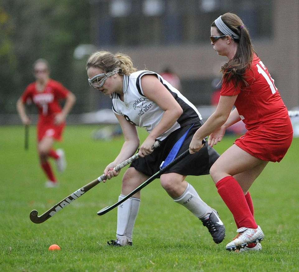 Commack's Maddie Messinger is defended by Smithtown East's