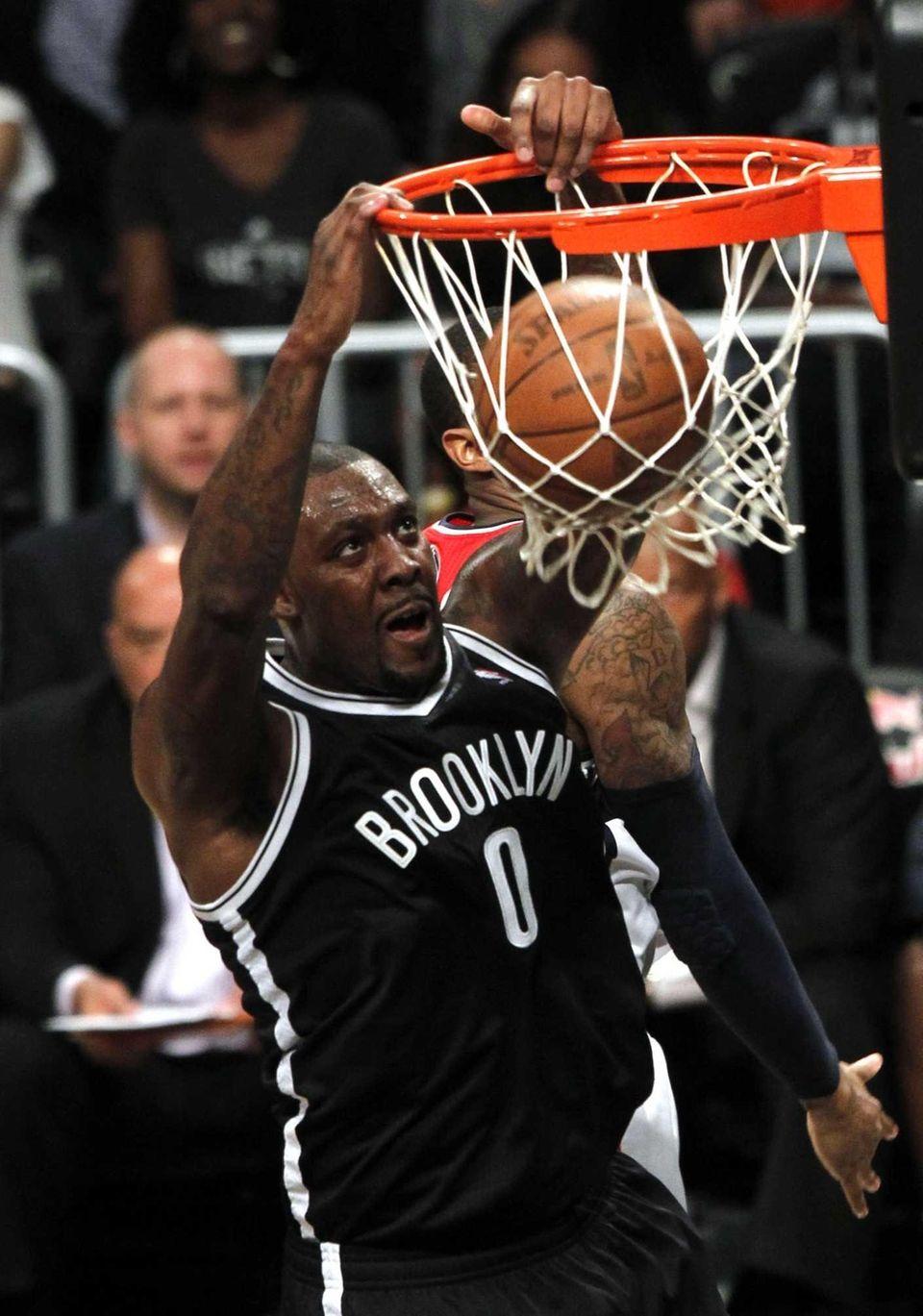 Andray Blatche dunks during an NBA preseason basketball