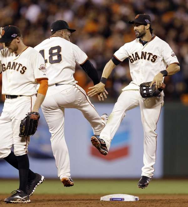 Angel Pagan and Pablo Sandoval celebrate after Game