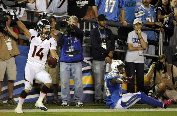 Denver Broncos wide receiver Brandon Stokley reacts after