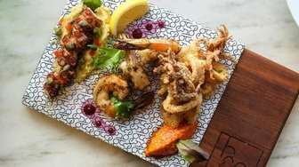 The daily fish board featuring grilled octopus over