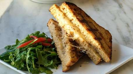 A grilled cheese sandwich with kefalotiri and black