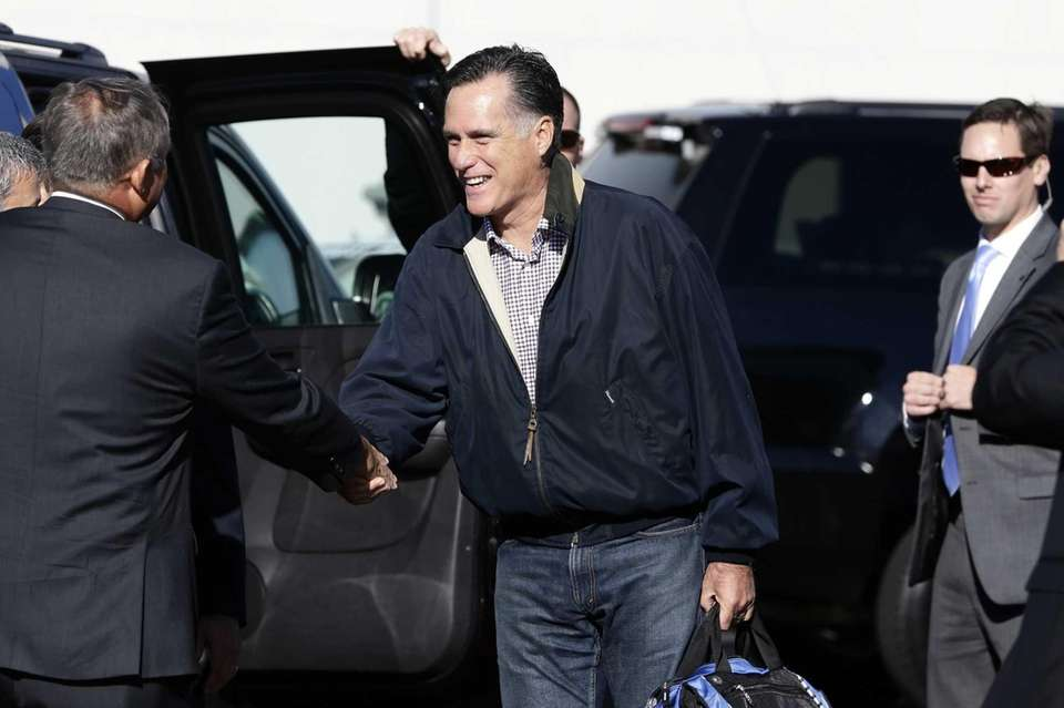 Republican presidential candidate Mitt Romney is greeted as