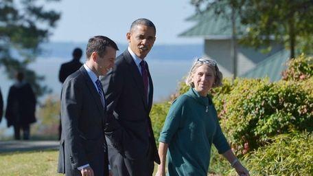 President Barack Obama walks with senior White House