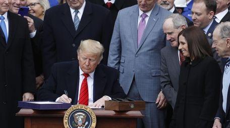President Donald Trump signs the U.S.-Mexico-Canada Agreement (USMCA)