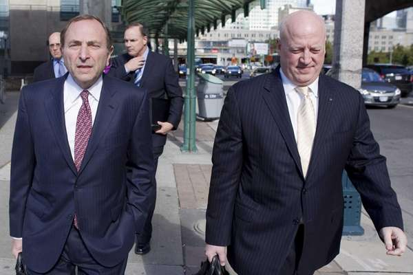 NHL commissioner Gary Bettman, left, arrives with deputy