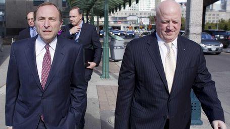 NHL commissioner Gary Bettman, left, arrives with deputy