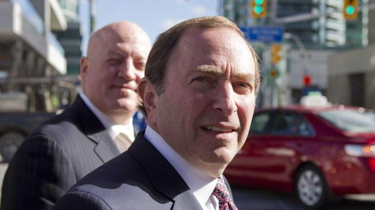 NHL commissioner Gary Bettman, foreground, arrives with deputy