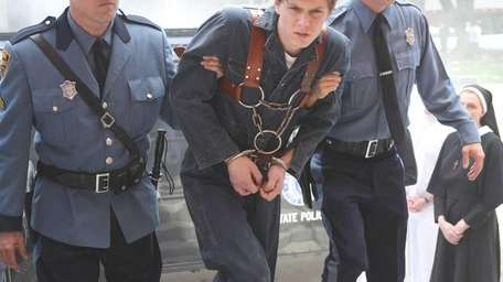 Evan Peters, center, in a scene from