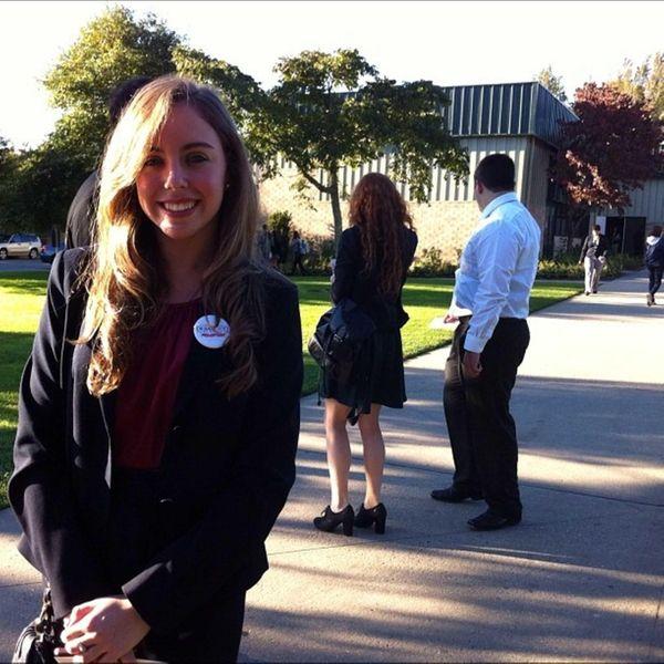 Allison Roye, 18, of Huntington, waits on line