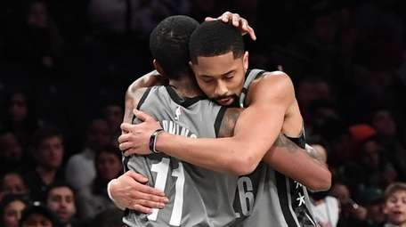 Nets guards Kyrie Irving and Spencer Dinwiddie embrace