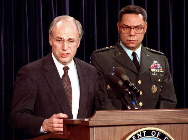 Defense Secretary Dick Cheney, left, speaks to reporters