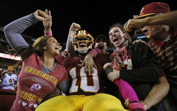 Washington Redskins quarterback Robert Griffin III celebrates with